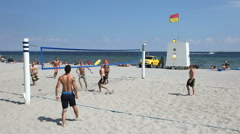 Life on the beach featuring beach volley Stock Footage