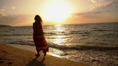 Free Happy Romantic Woman Walking on Beach at Sunset. Slow Motion. Stock Footage