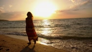 Stock Video Footage of Free Happy Romantic Woman Walking on Beach at Sunset. Slow Motion.