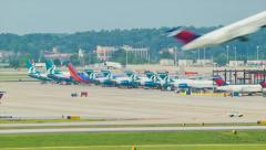 Airplane Takeoff with Terminals and Airliners in Background Stock Footage