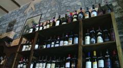 Bottles ot italian wine in typical store tilt Stock Footage