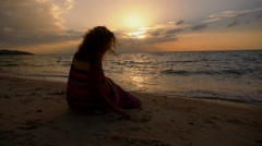 Girl Drawing Heart on a Sand at Sunset. Slow Motion. Stock Footage
