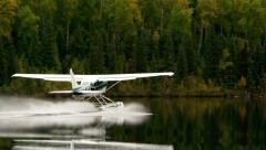 Alaskan bush plane on long take off Stock Footage