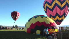 One hot air balloon inflating & 1 launching-C6-HD P-4197 Stock Footage