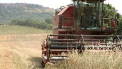 Combine working on wheat field: farm, farmer, agriculture, harvesting, Stock Footage