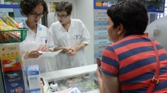 A patient buying medicine in a policlinic. Stock Footage