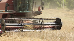 particular of a combine harvester in field wheat in a farm: field, countryside, - stock footage