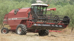 particular of combine working in field of wheat - stock footage