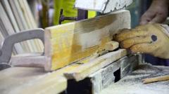 carpenter cutting wood on circular blade saw (selective focus) - stock footage