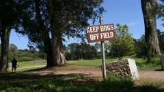 Keep dogs off field sign in park Stock Footage