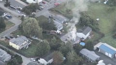 Firefighters Saving Burning Family Home - Aerial 2 Stock Footage