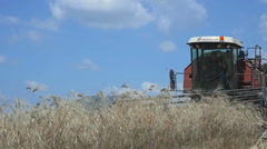 Harvesting equipment at work in a field of wheat: slow motion clip Stock Footage
