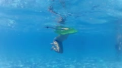 Happy active child in the swimming pool, underwater view Stock Footage