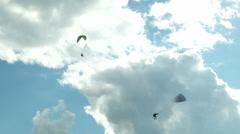 Acrobatic paragliding synchro white yellow 31 (slow motion) Stock Footage