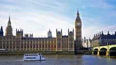 House of parliament and big ben with boat passing on thames river under westm Stock Footage