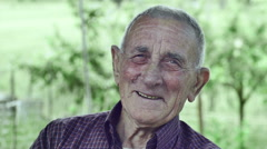 Smiling happy wrinkled old man: elderly, countryside, outdoor, portrait, Stock Footage
