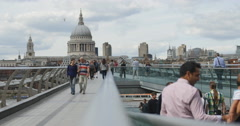 Tourists cross London Millennium footbridge 4K Stock Footage