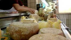 Woman in italian cheese store putting in order Stock Footage
