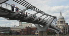 Tourists enjoy view from Millennium footbridge 4K Stock Footage