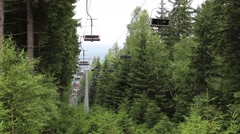 Chairlift in the mountains Stock Footage