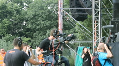 Cameraman Dolly Track,cameras and media photographers on music festival Stock Footage