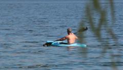 Man Rowing in Kayak Across Pristine Blue Waters Stock Footage