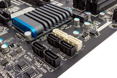electronic collection - digital components on computer mainboard - stock photo