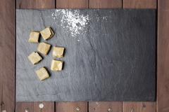 Caramels and sugar on slate plate Stock Photos