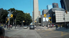 POV driving shot through downtown Toronto induding streetcars Stock Footage