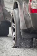 suv car run on flat tire - stock photo