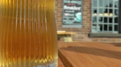 Sparkling beer in outside pub beer garden Stock Footage