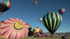 Smiley face balloon inflates as others lift off-C6-HD P-4233 Stock Footage