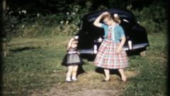 1115 - sisters dance it up in the driveway - vintage film home movie Stock Footage
