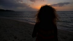 Freedom, Pleasure and Joy Concept. Woman with Curly Hair on the Beach at Sunset. Stock Footage