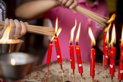 Close up of children lighting incense Stock Photos