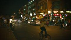 phnom penh, cambodia - 29 dec 2013: night traffic on city streets. dominated - stock footage