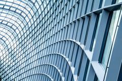 Close up of curved metal and glass building Stock Photos