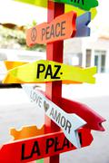 Colorful road signs to peace and love Stock Photos