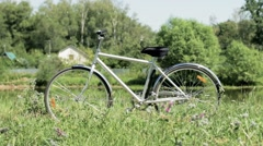 Bicycle near the pond staying still Stock Footage