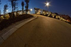 Madrid Río footbridge at night with a fisheye lens - stock photo