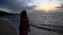 Stock Video Footage of Sad Woman at the Dusk Beach at Sunset. Loneliness Solitude and Sorrow Feeling.
