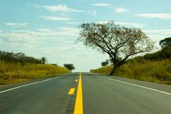 straight road touching the sky - stock photo