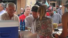 Brisk business at a street fair liquor stand Stock Footage