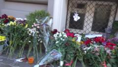 Flowers and candles from the Russians at the Embassy of the Netherlands Stock Footage