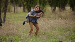Woman Riding On Man's Back imagining that flying Stock Footage