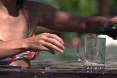 Woman pouring beer to stein, steadycam shot, slow motion shot at 240fps Stock Footage