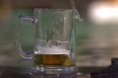 Beer pouring to the stein, steadycam shot, slow motion shot at 240fps Stock Footage