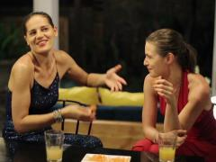 Women chatting and eating snacks at the party Stock Footage