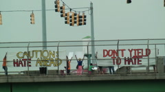 Pro-amnesty protesters overpass bridge Stock Footage