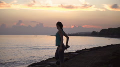 Woman exercising and man jogging at sunrise, steadycam shot, slow motion shot - stock footage